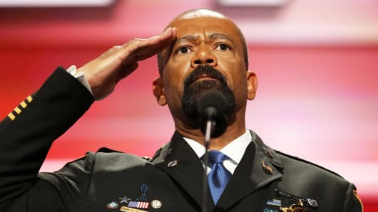 Milwaukee County Sheriff David Clarke salutes the crowd prior to delivering a speech on the first day of the Republican National Convention on July 18, 2016.