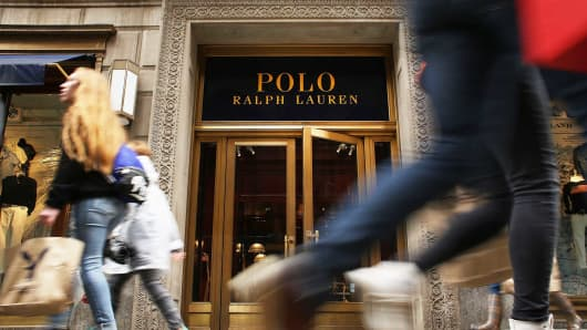 People walk by Ralph Lauren's Fifth Avenue Polo store in New York City.