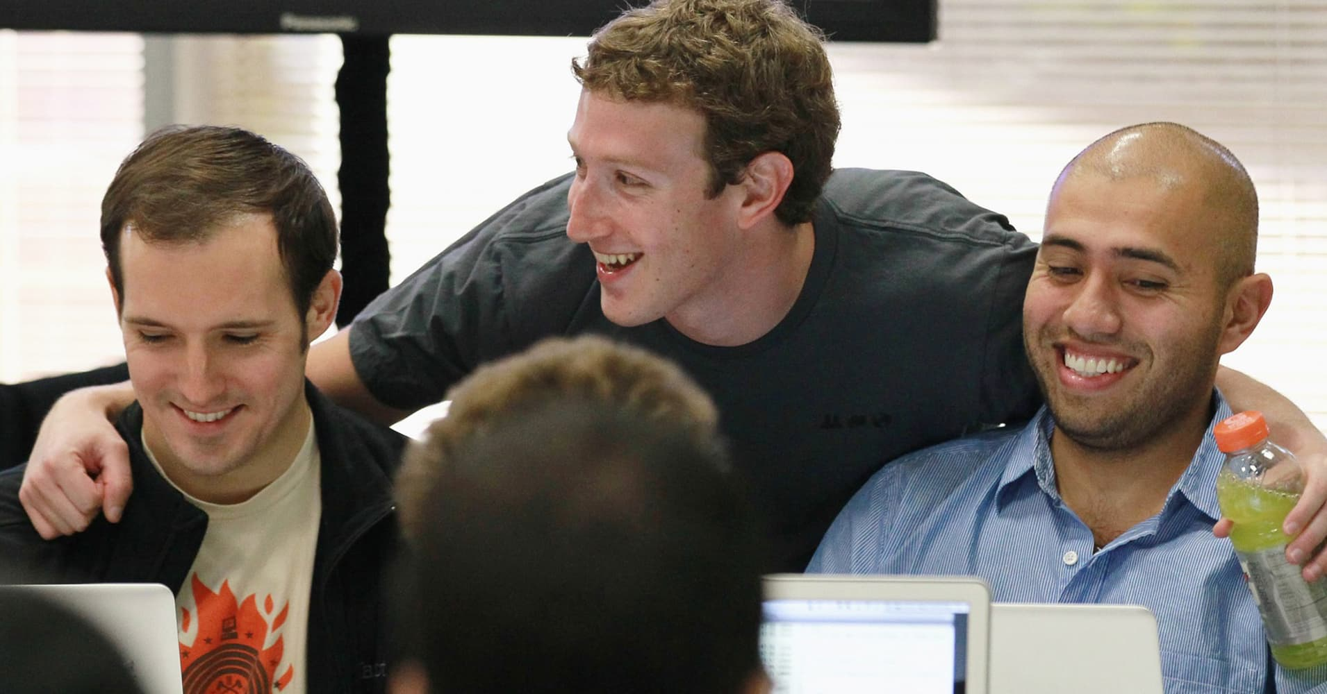 Facebook founder and CEO Mark Zuckerberg with Facebook employees.