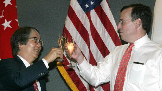 Frank Lavin, then U.S. ambassador to Singapore, toasts with Singapore's Ambassador-at-large Tommy Koh at the U.S. embassy in Singapore on August 1, 2003.