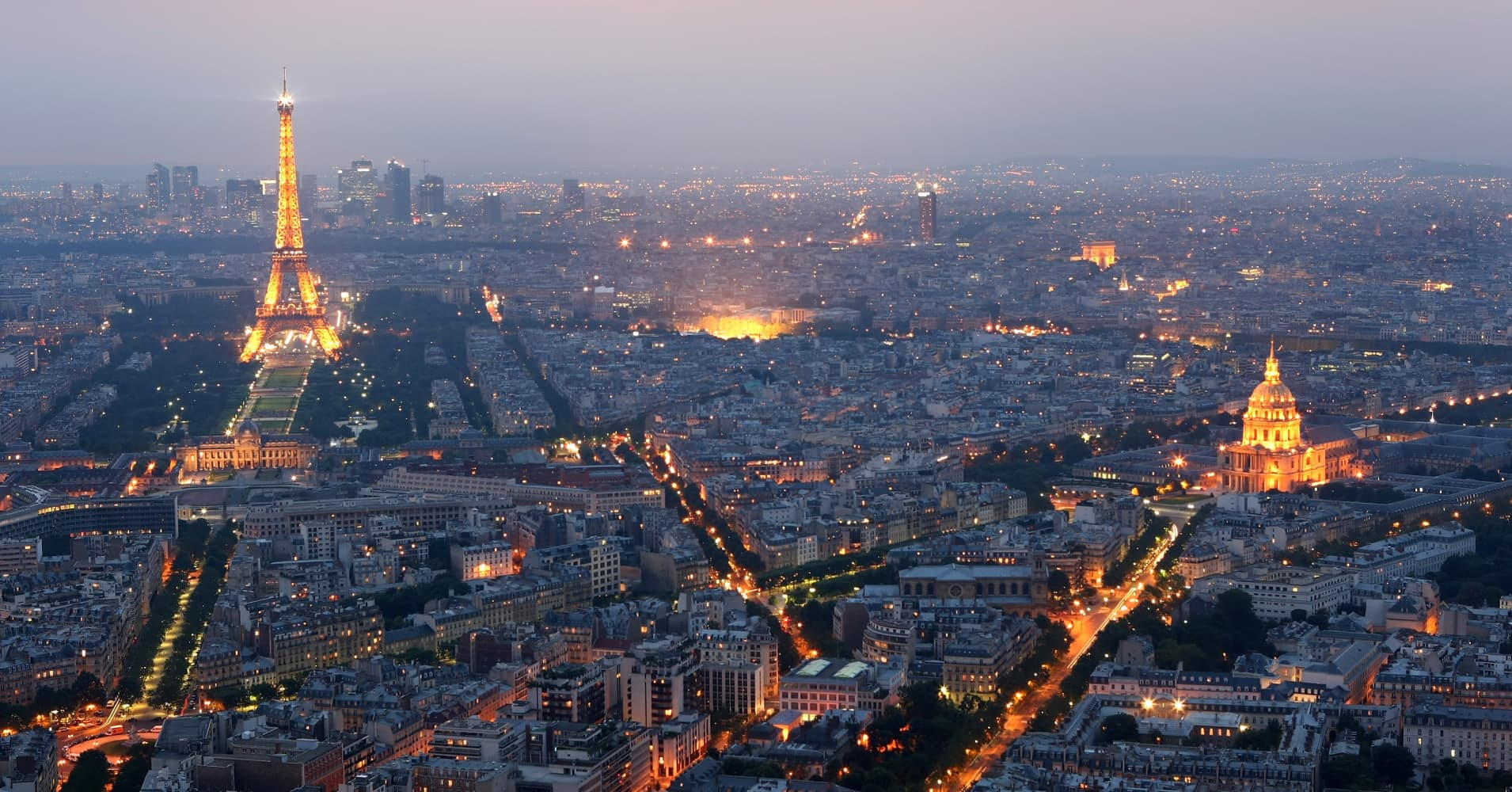 General view of Paris at dusk with the Eiffel Tower and the Hotel des Invalides prominent