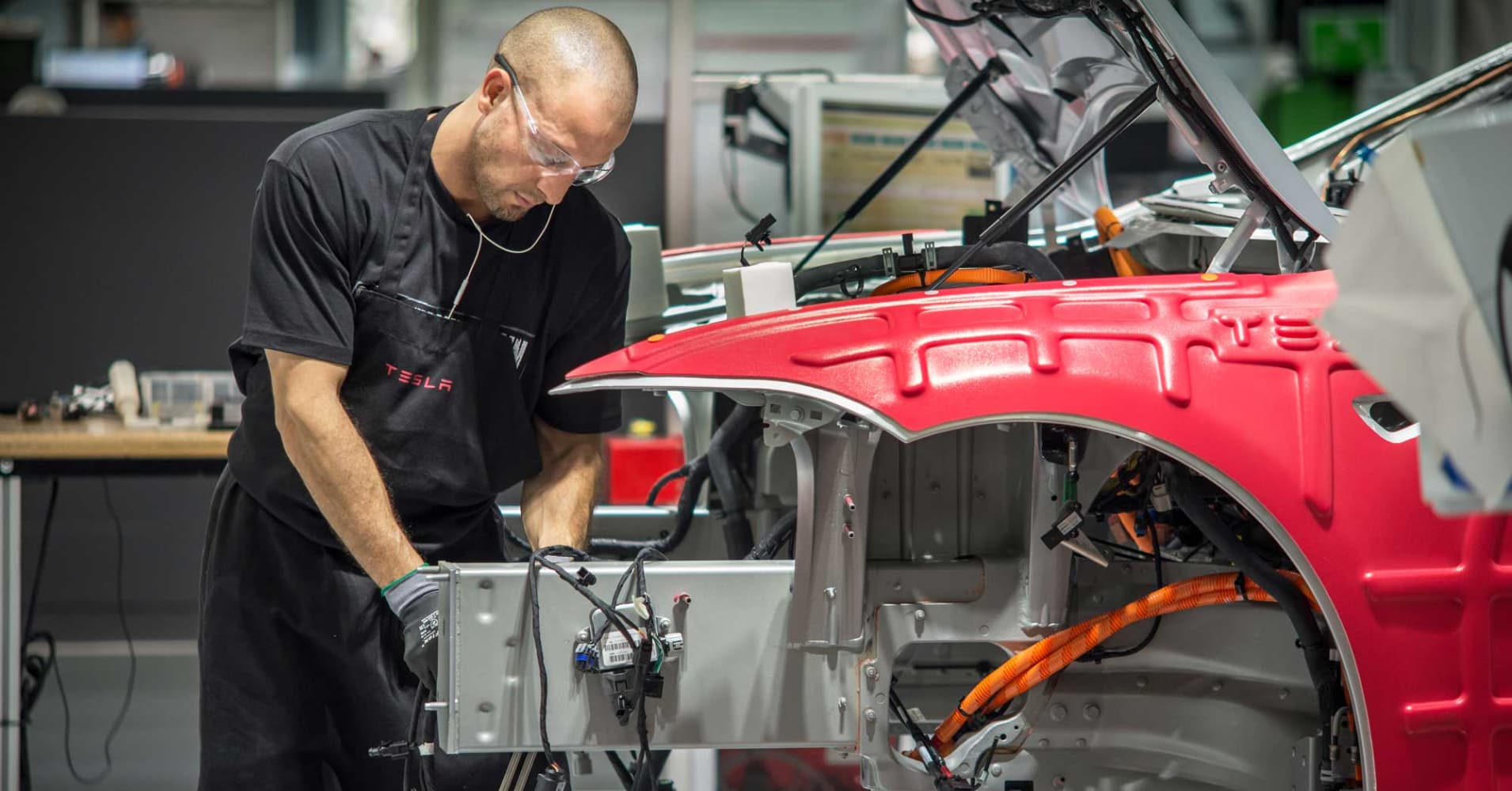 Workers assemble cars on the line at the Tesla's factory in Fremont, California.