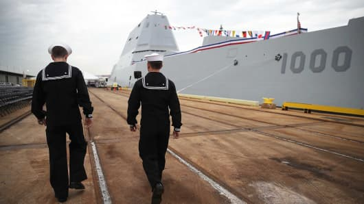 Sailors walk past the US Navy's new guided missile destroyer DDG 1000 USS Zumwalt in Baltimore, Maryland. The Zumwalt is the lead ship of a class of next-generation multi-mission surface combatants.