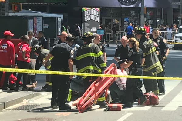 First responders are assisting injured pedestrians after a vehicle struck pedestrians on a sidewalk in Times Square in New York, U.S., May 18, 2017.