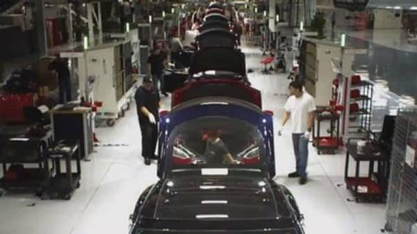 Tesla workers are passing out on the factory floor, according to a report