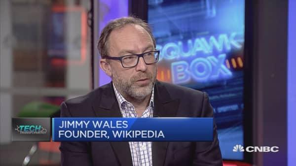 Bringin Wiki-style community alongside professional journalists: Wikipedia founder