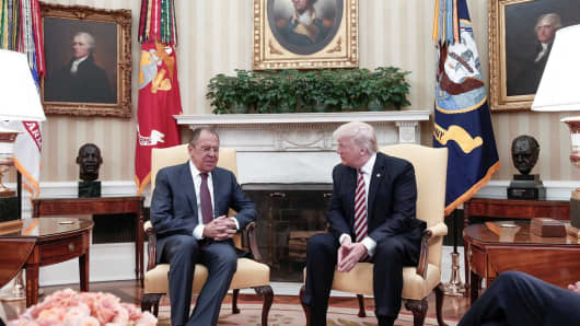 U.S. President Donald Trump (R) and Russia's Foreign Minister Sergei Lavrov (L) meet at the Oval Office of the White House in Washington, D.C. on May 10, 2017.