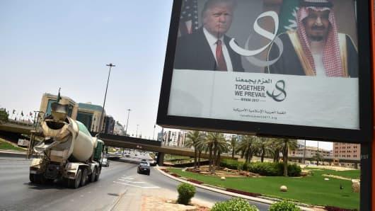 A giant billboard bearing portraits of US President Donald Trump and Saudi Arabia's King Salman, is seen on a main road in Riyadh, on May 19, 2017.