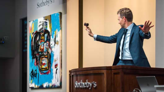 "The auction of Jean-Michel Basquiat's ""Untitled"" at Sotheby's."