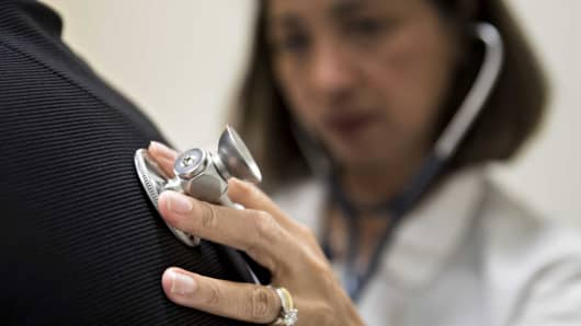 A medical doctor examines a patient with a stethoscope at a CCI Health and Wellness Services health center in Gaithersburg, Maryland.