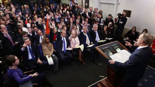 White House Press Secretary Sean Spicer (R) takes questions from members of the White House press corps during a daily press briefing at the James Brady Press Briefing Room February 14, 2017 at the White House in Washington, DC.