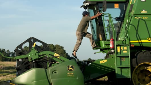 Farmer Claudio Lagomarsino cleans his John Deere combine after a day of harvesting wheat near Salto, Argentina.
