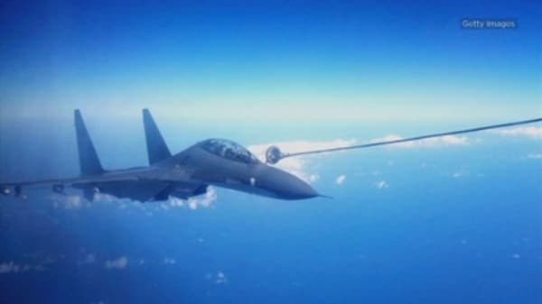 Two Chinese jets intercepted a U.S. military aircraft over the East China Sea