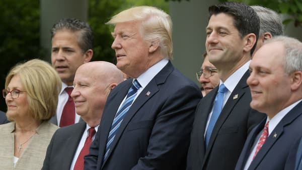 President Donald Trump (C) stands with House Speaker Paul Ryan (2nd R) during a press conference in the Rose Garden of the White House following the House of Representative vote on the health care bill on May 4, 2017 in Washington, DC.