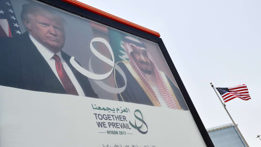 A giant billboard bearing portraits of US President Donald Trump and Saudi Arabia's King Salman, is seen on a main road in Riyadh, on May 19, 2017.