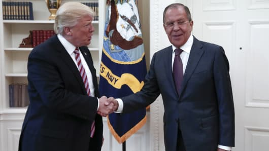 President Donald Trump (L) of the United States shakes hands with Russia's Foreign Minister Sergei Lavrov as they meet for talks in the Oval Office at the White House.