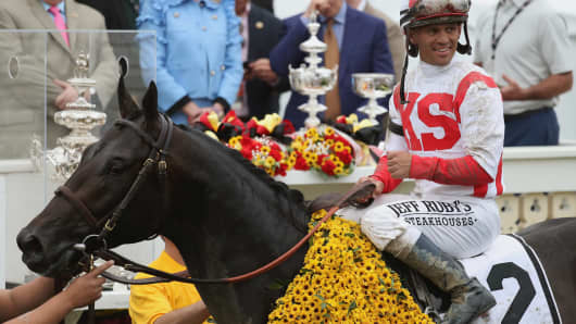Javier Castellano #2 rider of Cloud Computing celebrates in the winner's cirlce after winning the 142nd running of the Preakness Stakes at Pimlico Race Course on May 20, 2017 in Baltimore, Maryland.