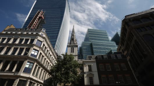 The Church of St. Margaret Pattens (C) stands next to the under-construction 37-storey skyscraper at 20 Fenchurch Street (L) which has been nicknamed the 'Walkie-Talkie' on July 10, 2013 in London, England.