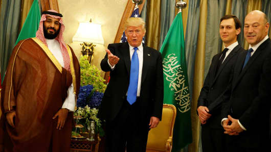 President Donald Trump, flanked by White House senior advisor Jared Kushner (2nd R) and chief economic advisor Gary Cohn (R), delivers remarks to reporters after meeting with Saudi Arabia's Deputy Crown Prince and Minister of Defense Mohammed bin Salman (L) at the Ritz Carlton Hotel in Riyadh, Saudi Arabia May 20, 2017.