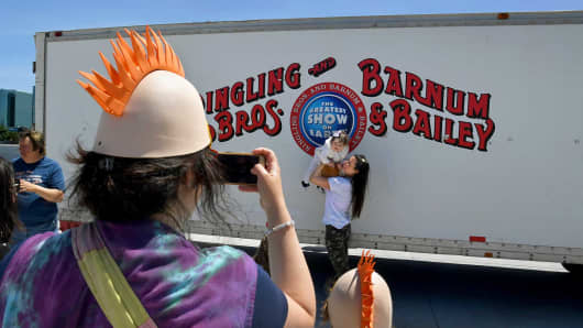 Fans take a picture in front of a Ringling Brothers truck in Uniondale, NY. After a 146 year run, the Ringling Bros. and Barnum & Bailey Circus will end with an evening performance at the Nassau Veterans Memorial Coliseum on Sunday, May 21st.
