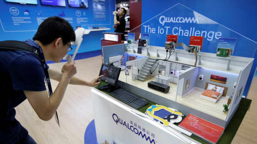 A man visits Qualcomm's booth at the Global Mobile Internet Conference 2017 in Beijing, China April 28, 2017.