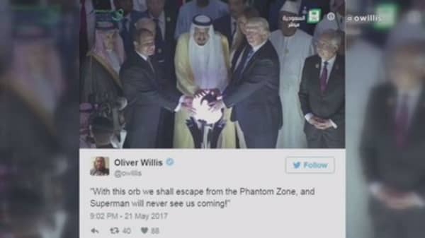 President Donald Trump stood in front of a glowing orb at the Global Center for Combating Extremist Ideology, sparking a series of Internet memes.