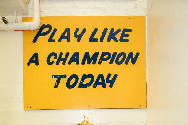 "Buffett's sign is inspired by Notre Dame's famous ""Play Like A Champion Today"" sign"