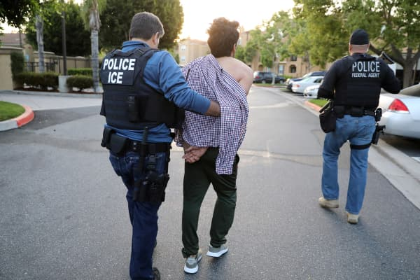 U.S. Immigration and Customs Enforcement (ICE) officers, arrest an immigrant in San Clemente, California.