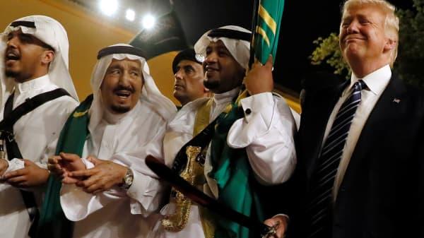 Saudi Arabia's King Salman bin Abdulaziz Al Saud (2nd L) welcomes U.S. President Donald Trump to dance with a sword during a welcome ceremony at Al Murabba Palace in Riyadh, Saudi Arabia May 20, 2017.