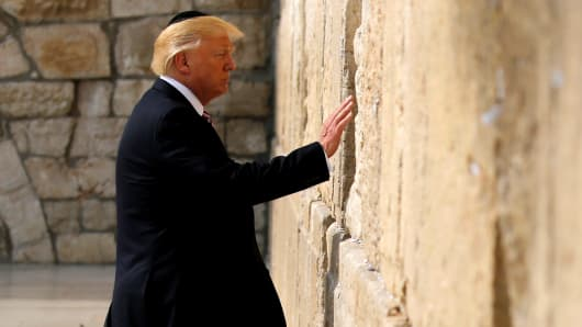 President Donald Trump prepares to leave a note at the Western Wall in Jerusalem May 22, 2017.