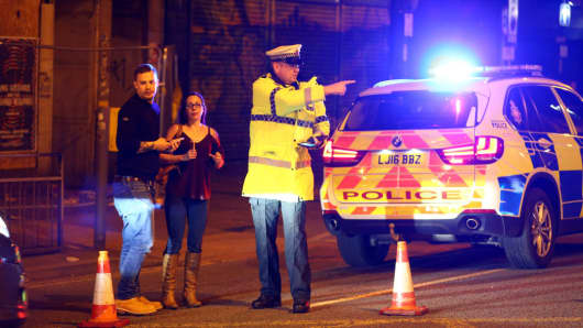 Police stand by a cordoned off street close to the Manchester Arena on May 22, 2017 in Manchester, England. There have been reports of explosions at Manchester Arena where Ariana Grande had performed this evening.