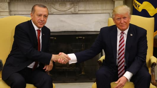 U.S President Donald Trump (R) and President of Turkey Recep Tayyip Erdogan (L) shake hands during a meeting at the Oval Office of the White House in Washington D.C., United States on May 16, 2017.