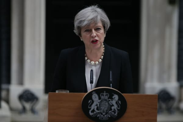 Britain's Prime Minister Theresa May delivers a statement outside 10 Downing Street in central London on May 23, 2017 after an emergency meeting of the Cobra committee in response to a deadly suspected suicide bombing in the northern city of Manchester. Children were among 22 people killed and dozens injured in a suspected suicide bombing at a pop concert by US star Ariana Grande, in Britain's deadliest terror attack in 12 years.