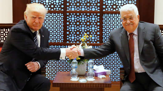 President Donald Trump (L) and Palestinian President Mahmoud Abbas shake hands before beginning their meeting at the Presidential Palace in the West Bank city of Bethlehem May 23, 2017.