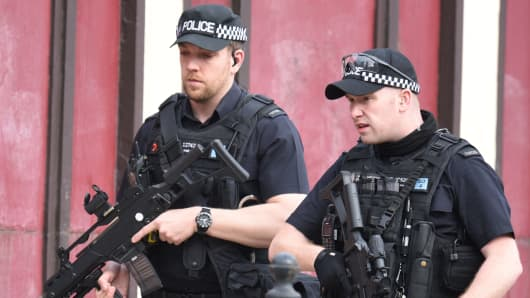 Armed police patrolling near Manchester Arena following a deadly terror attack on the venue on the evening of May 22, 2017.