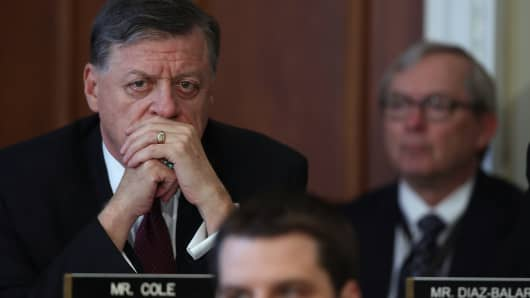 Rep. Tom Cole (L) (R-OK) looks on during a House Budget Committee markup of the Republican health care bill on Capitol Hill on March 16, 2017 in Washington, DC.