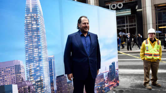 Marc Benioff, chairman and chief executive officer of Salesforce.com Inc., stands in front of a poster during a topping off ceremony for the Salesforce Tower in San Francisco, California, on Thursday, April 6, 2017.
