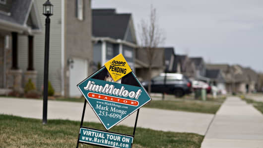 A 'For Sale' sign stands outside a new home in Dunlap, Illinois,