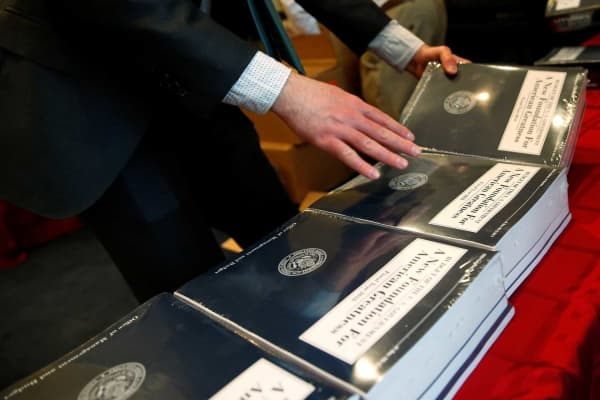 The White House Fiscal Year 2018 budget is placed on tables by House staff members at the House Budget Committee on Capitol Hill in Washington, May 23, 2017.