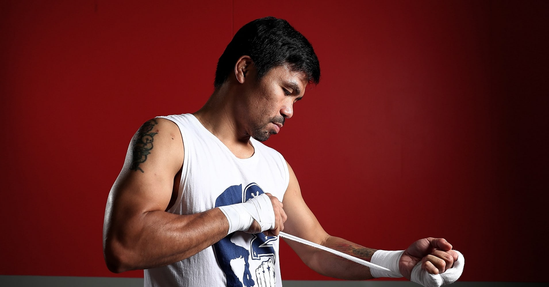 Manny Pacquiao warps his hands before a training session.