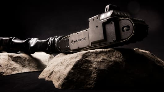 The Guardian S, one of Sarcos' robots, is a 13-pound snake-like all-terrain machine, powered remotely by humans engineers.