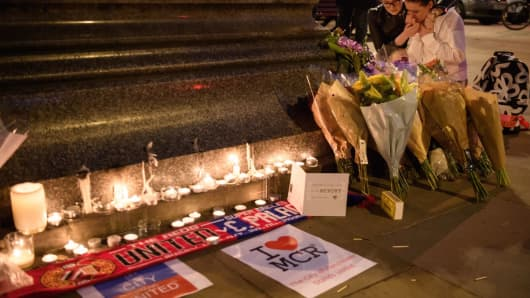 Floral tributes on May 23, 2017 in Manchester, England. An explosion at Manchester Arena on May 22, 2017 has left 22 fatalities and 59 injured.
