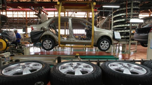 Proton Holdings Saga vehicles move along the assembly line at the company's factory in Shah Alam, Selangor, Malaysia.