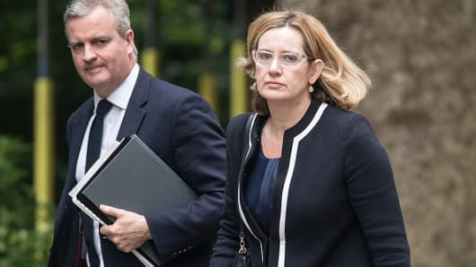 Home Secretary Amber Rudd (R) arrives for a COBRA meeting in Downing Street on May 23, 2017