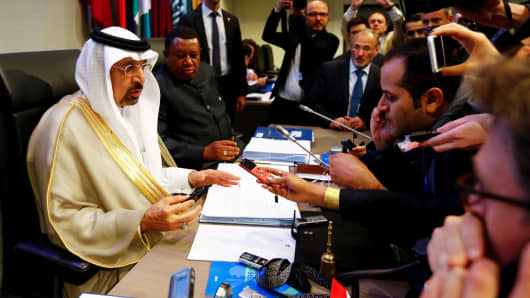 OPEC President, Saudi Arabia's Energy Minister Khalid al-Falih, and OPEC Secretary General Mohammad Barkindo talk to journalists before the beginning of a meeting of the Organization of the Petroleum Exporting Countries (OPEC) in Vienna, Austria, May 25, 2017.