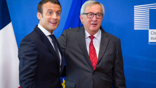 rench President Emmanuel Macron (L) and European Commission President Jean-Claude Juncker pose during their meeting at the European Commission headquarters.
