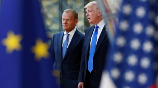 President Donald Trump (R) walks with the President of the European Council Donald Tusk in Brussels, Belgium, May 25, 2017.