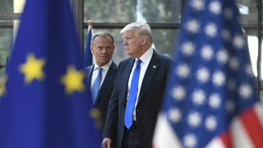 European Council President Donald Tusk (L) speaks to US President Donald Trump (R) as he welcomes him at EU headquarters.