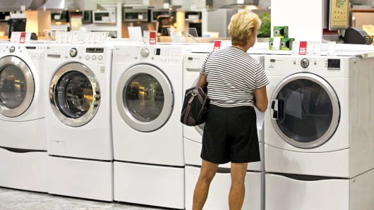 A shopper looks at washers and dryers in Glenview, Illinois.