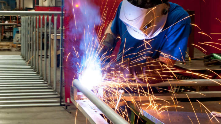 An employee welds a joint on an industrial clothing rack at Staber Industries in Groveport, Ohio.